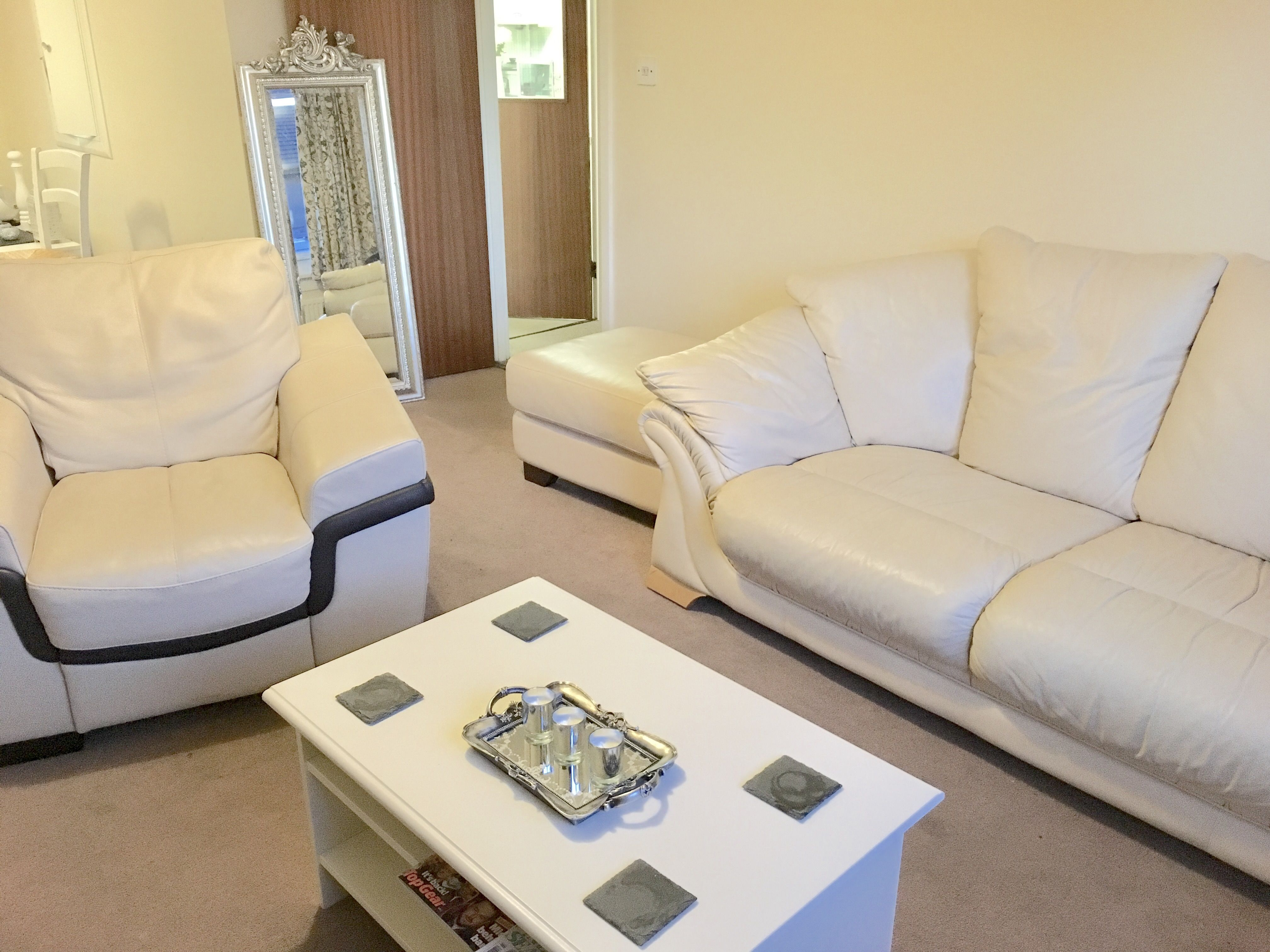 Our lounge with a statement coffee table mirror tray