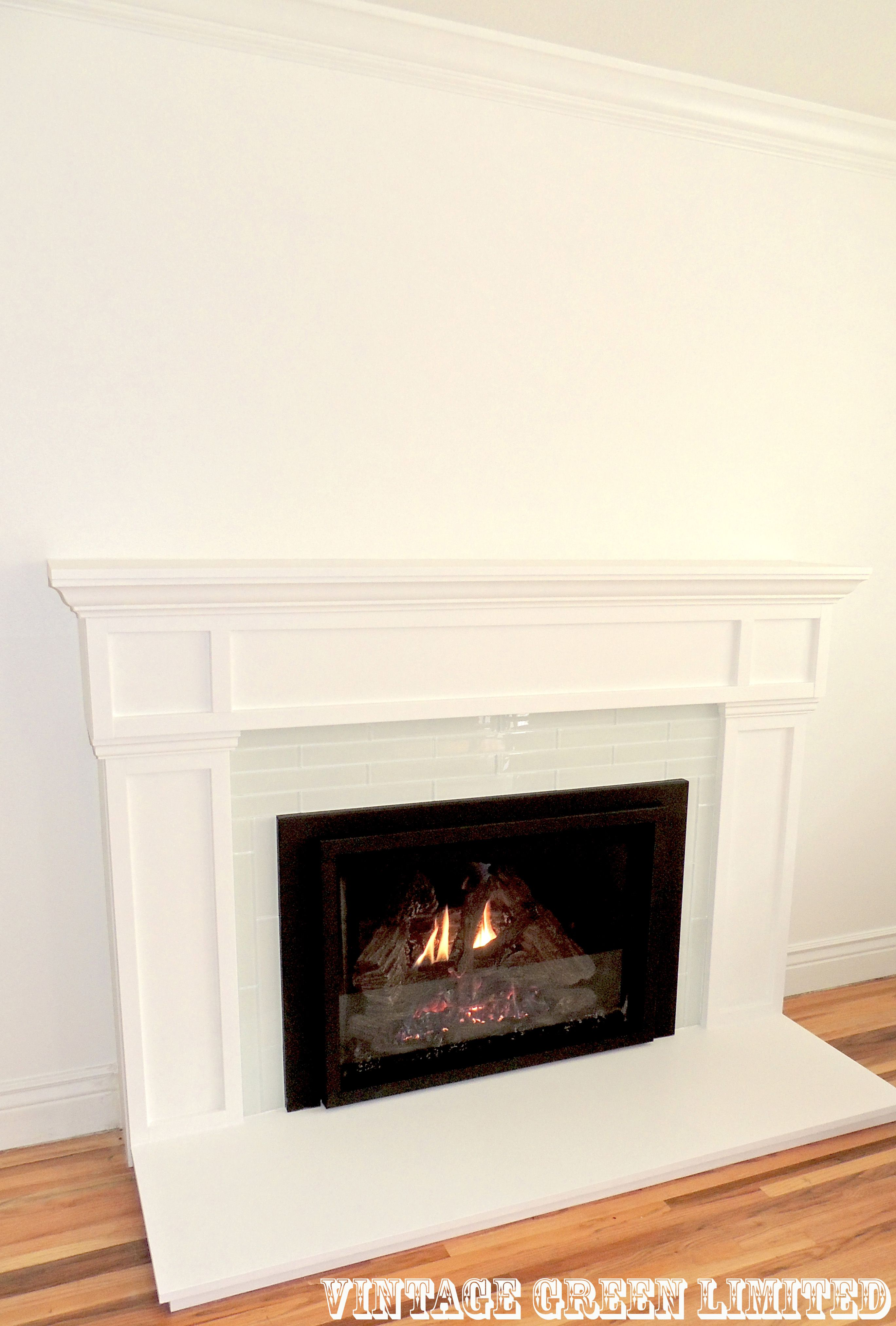 Fireplace Makeover, white fireplace, glass tile, wood