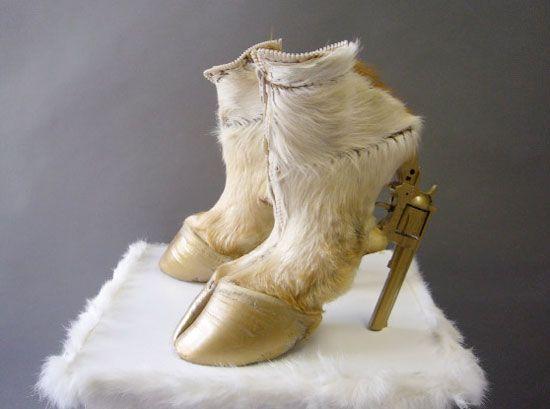 'vegas girl' hoof shoe by german artist iris schieferstein, 2009.  toy pistol, cow hooves, zipper.