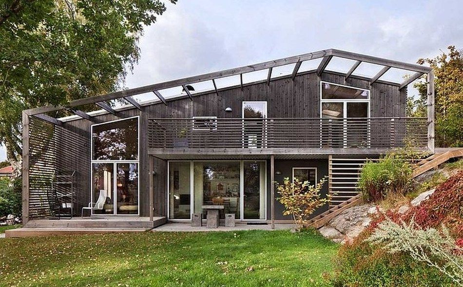 Magnifique maison bois sur 2 niveaux et son toit végétalisé en Suède