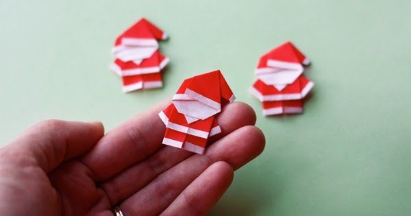 """I made wee origami Santas. Each guy is folded from two 1 1/2"""" squares of red paper. Have the kids tuck one inside your Christmas cards or s..."""