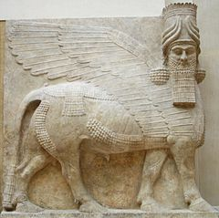An Assyrian winged bull, or lamassu, Louvre.
