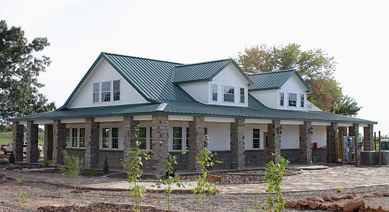 Gables brick wrap around porch metal building homes for Barn house plans with porches