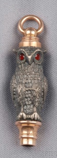 Antique Owl Watch Key, the engraved form with garnet eyes, silver and rose gold mount, lg. 1 1/2 in., dated 1871.