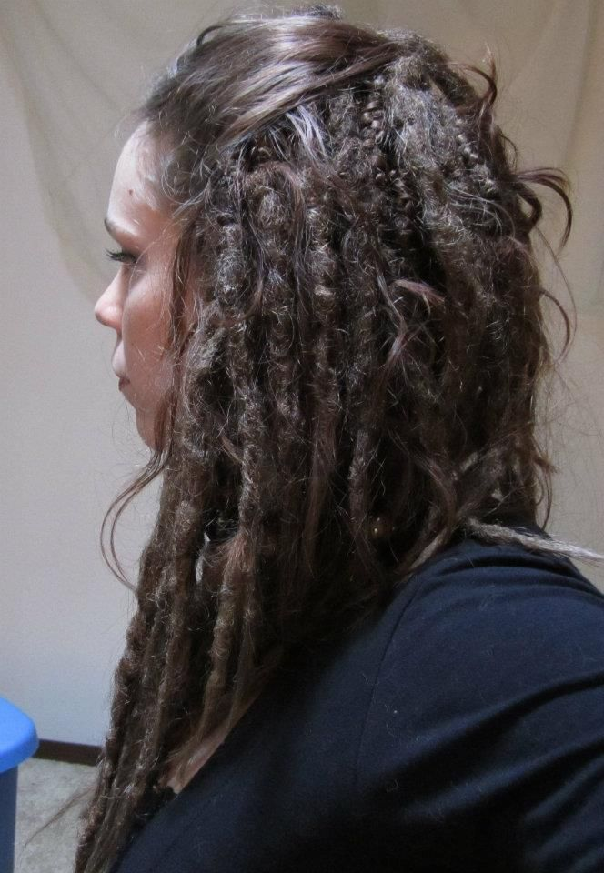 Light brown custom knotty dreadlock extensions. 40 single ended extensions installed on model. Create your own set of dreads from Iconic Locks on Etsy.  Model: Therin Mayhem