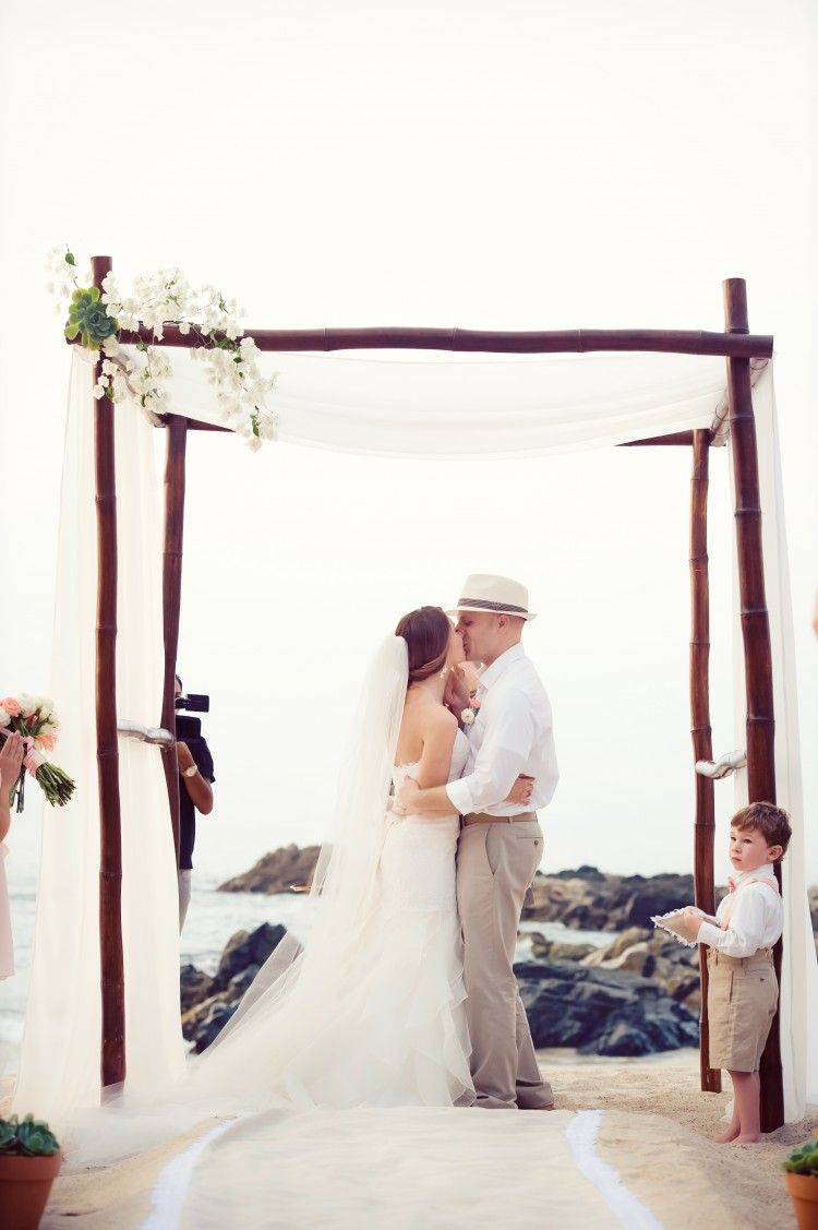 Chic beach wedding ceremony ideas wood structure simple flowers