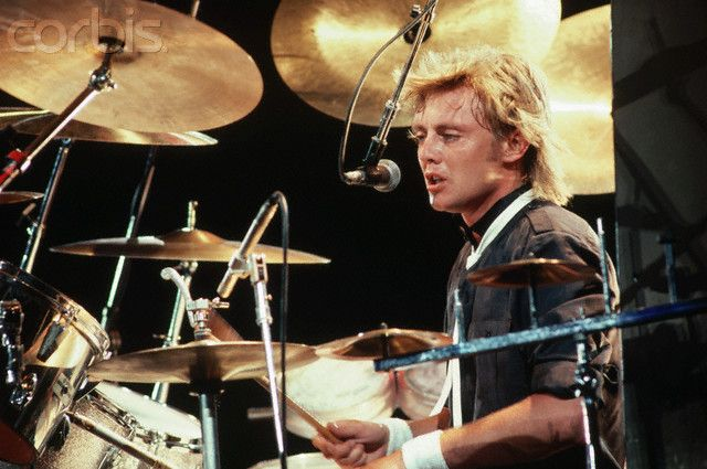 Roger Taylor of Queen Playing the Drums Photo by Neal ...