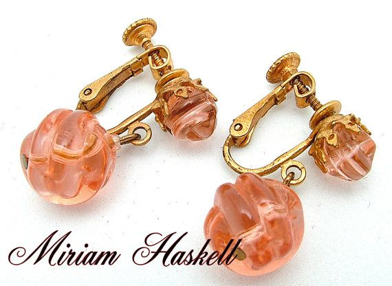 Vintage Miriam Haskell Dangle Earrings Art  /Delicate Dangle Vintage Earrings in a beautiful pink art glass, signed Miriam Haskell. This pair of vintage art glass earrings are triple signed. In block letters, MIRIAM HASKELL on the back of the bead, HASKELL on the lever, and on the button, it reads, PAT. NO. 3,176,475 / $80