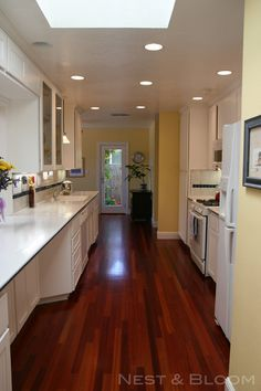kitchen makeover: white cabinetry + brazilian cherry floor