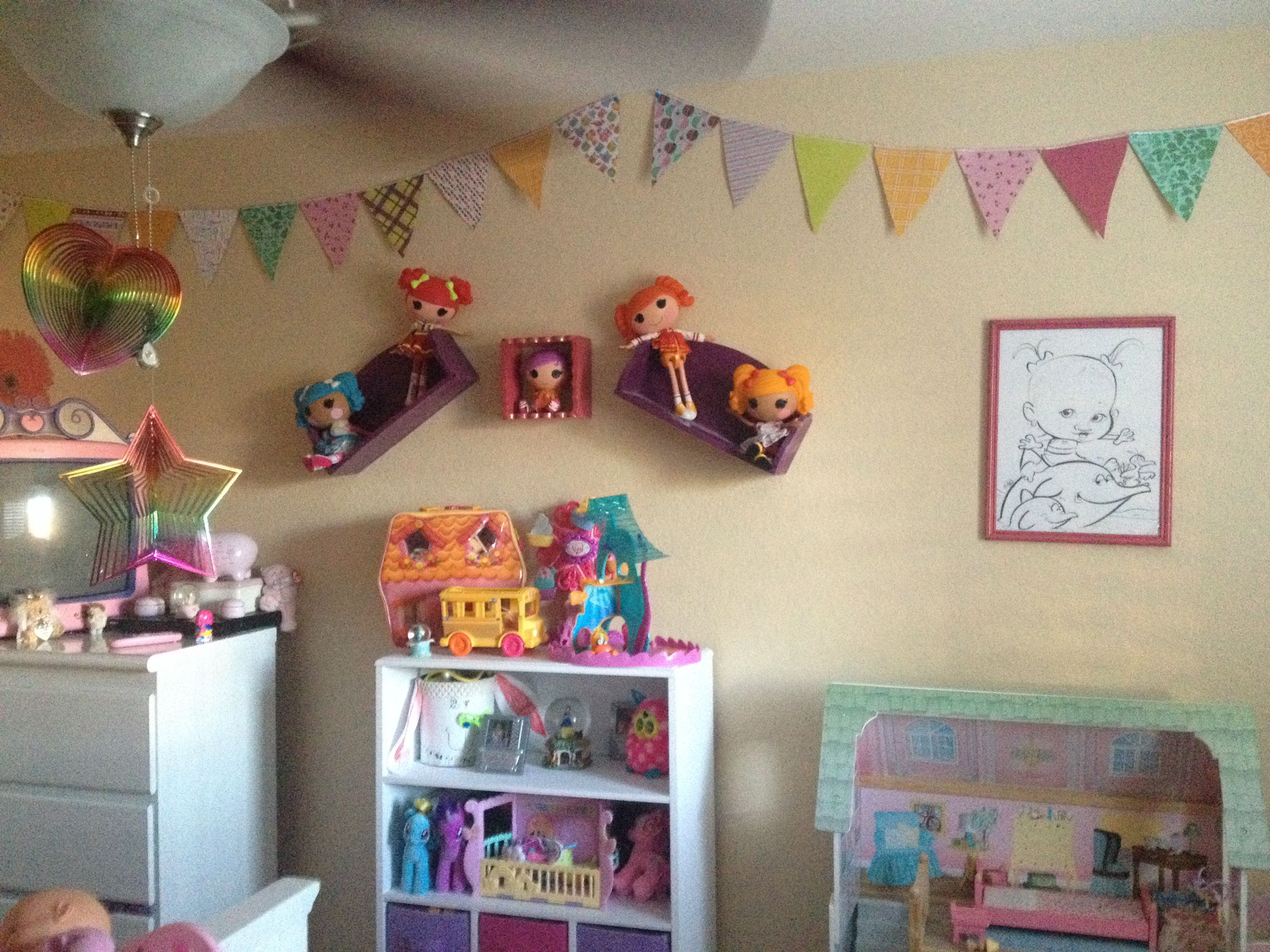Scrapbook paper bunting - and hung some shelves crooked for a somewhat different effect !