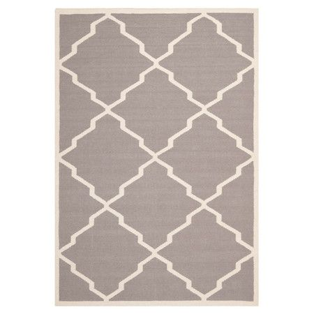 Showcasing a grey and ivory trellis motif, this handmade flatweave wool rug brings a pop of pattern to your dining room or den.   Produc...
