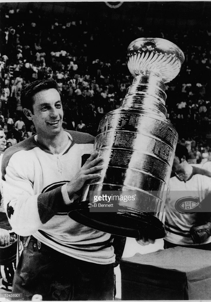 Jean Beliveau  4 of the Montreal Canadiens holds up the Stanley Cup Trophy  after defeating the St. Louis Blues in Game 4 of the 1969 Stanley Cup  Finals on ... 970f7a24f