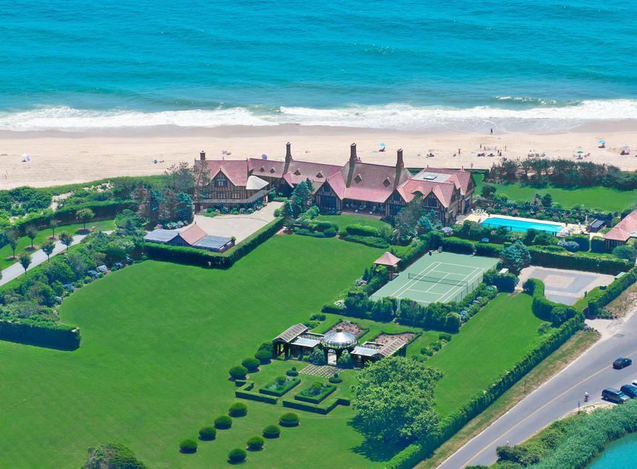 An English Tudor Style House Wooldon Manor Has A Pool House That Doubles As Hampton Estates Ocean House Dream Beach Houses