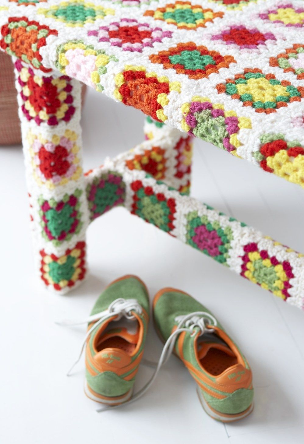 Crochet-covered furniture. Huh. Interesting idea but not a big fan of granny squares. I'd have to do something different.