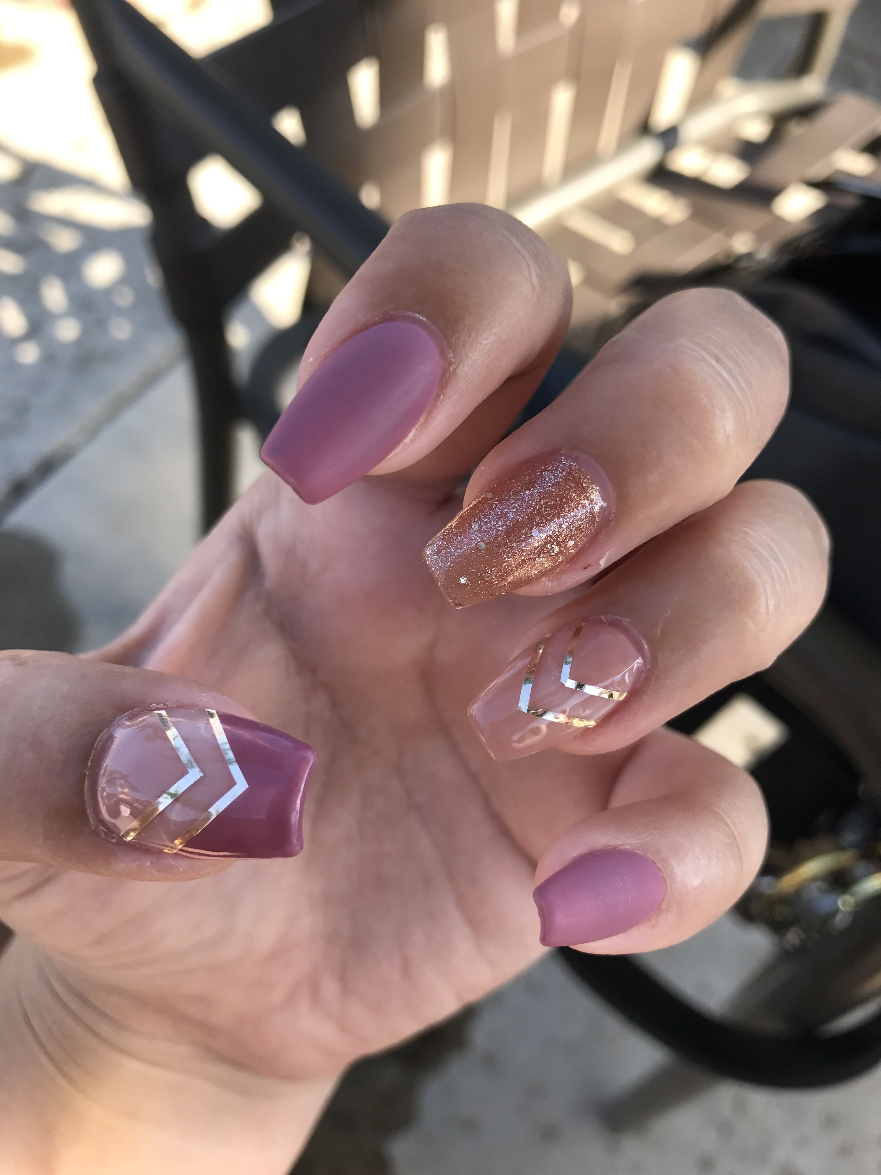 Purple Glitter And Nude Acrylic Nails With Gold Arrow Accents