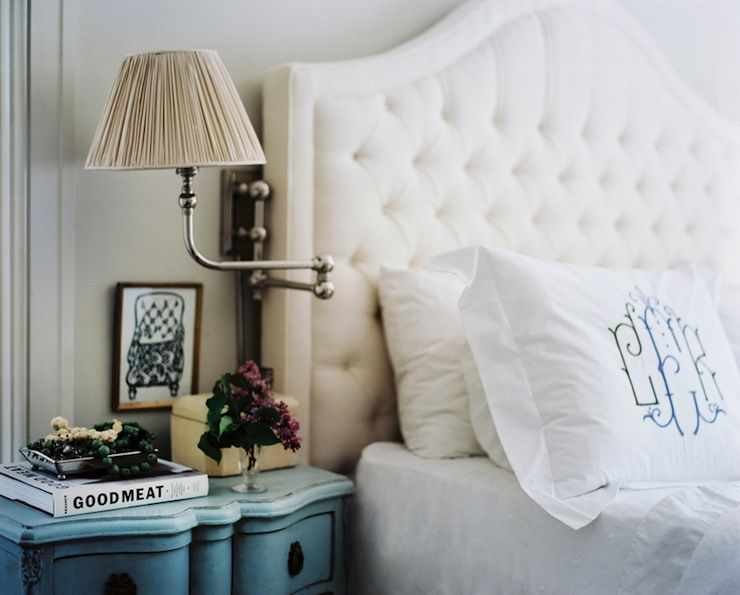 lonny magazine glam bedroom white camelback tufted bed blue vintage nightstands sconces