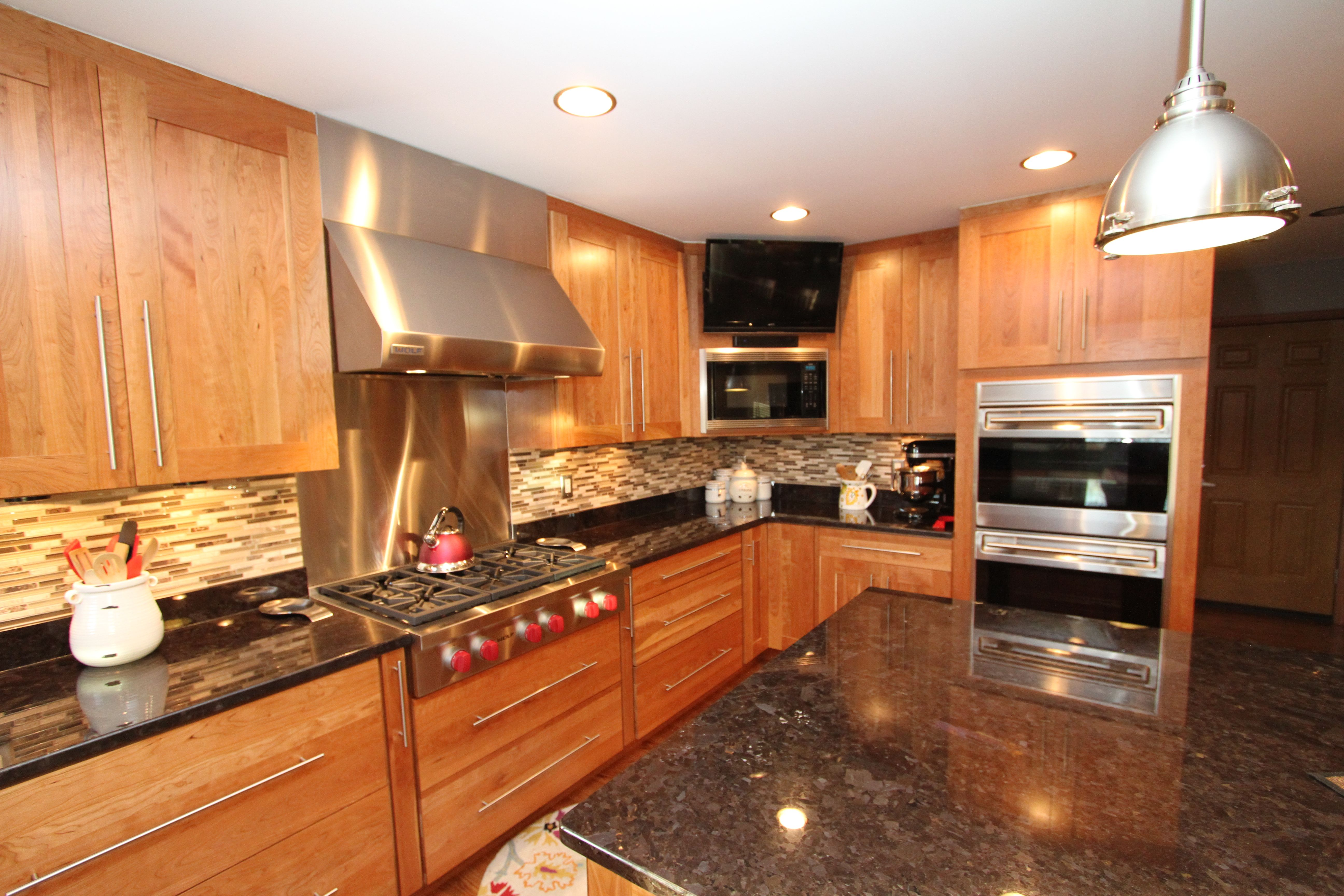 Natural cherry cabinets with granite countertops & an ... on Maple Kitchen Cabinets With Black Granite Countertops  id=21813