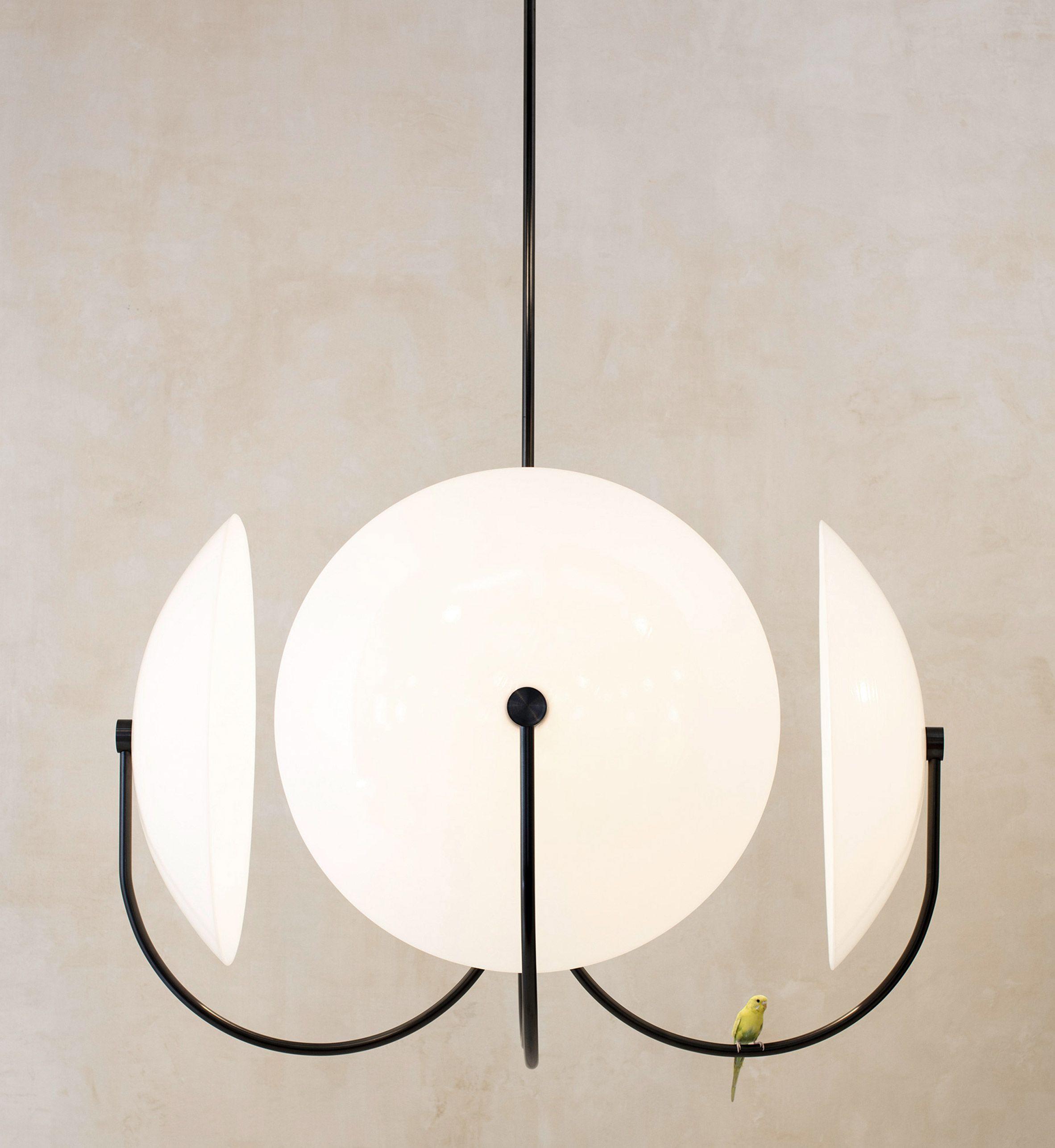 allied maker exploits circular and triangular geometries. Black Bedroom Furniture Sets. Home Design Ideas