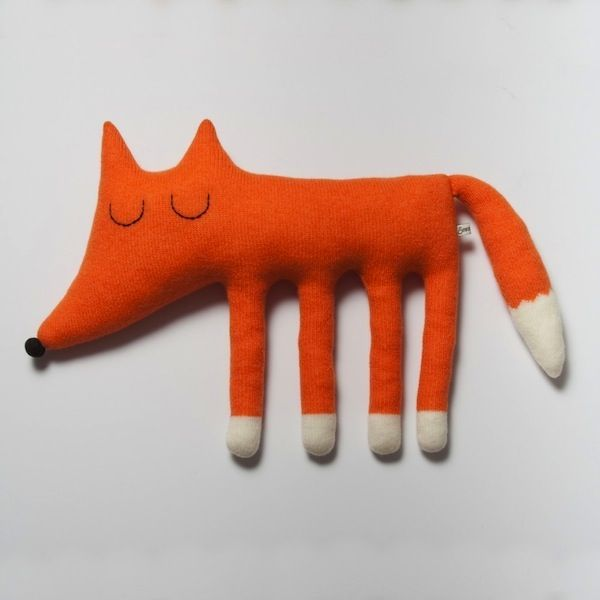 Sara Carr.  http://www.etsy.com/listing/62106912/large-monty-the-fox-lambswool-plush-made
