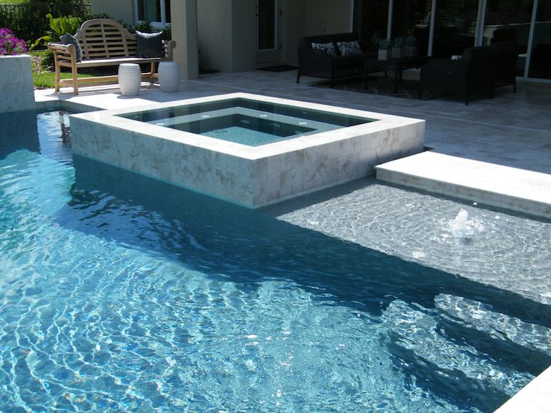 square spa raised above pool