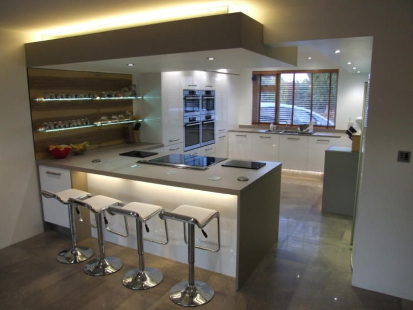 This kitchen features lots of lighting, decorative plinth lighting ...