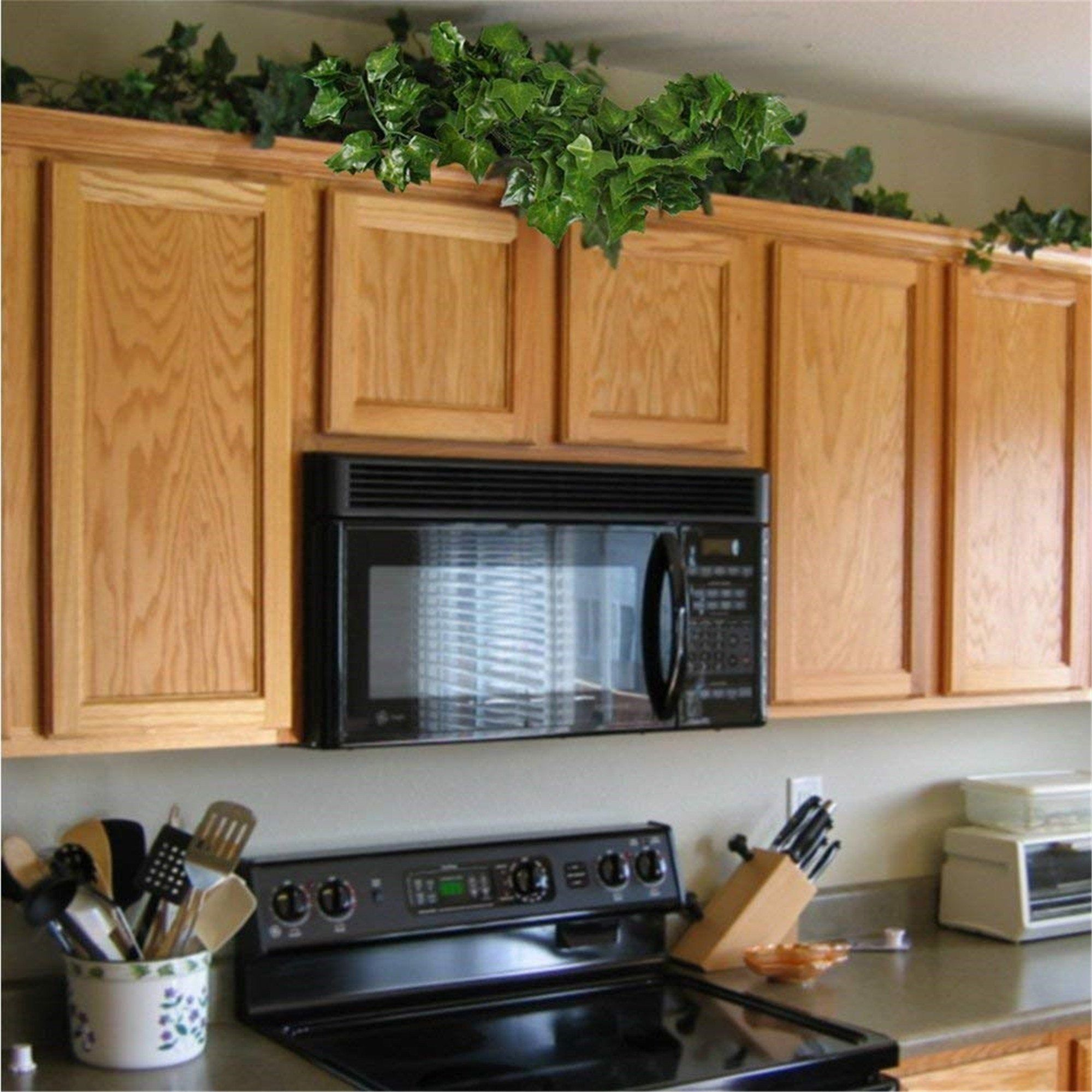 12 X Artificial Plants Of Vine False Flowers Ivy Hanging Etsy In 2021 Above Kitchen Cabinets Decorating Above Kitchen Cabinets Kitchen Cabinets Decor Kitchen plants top cabinets
