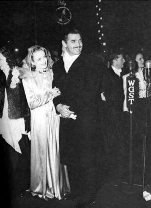 "Carole Lombard wearing Travis Banton. 1930s. Here she`s with Clark Gable, her husband, on the premiere of ""Gone With the Wind""."