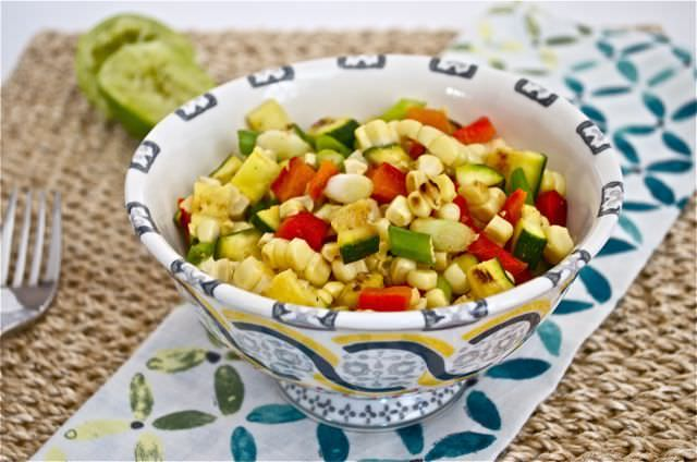 Grilled Corn, Pepper, and Zucchini Salad is veggies prepared on the grill and mixed with green onions and jalapeno with fresh lime juice and cilantro. This is a fresh and easy side dish or condiment for grilled meats, fish, or tacos!