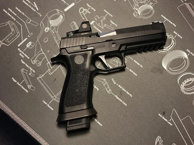 Pin by Dave Richardson on Sig Sauer P320 | Hand guns, Guns, Sig p320