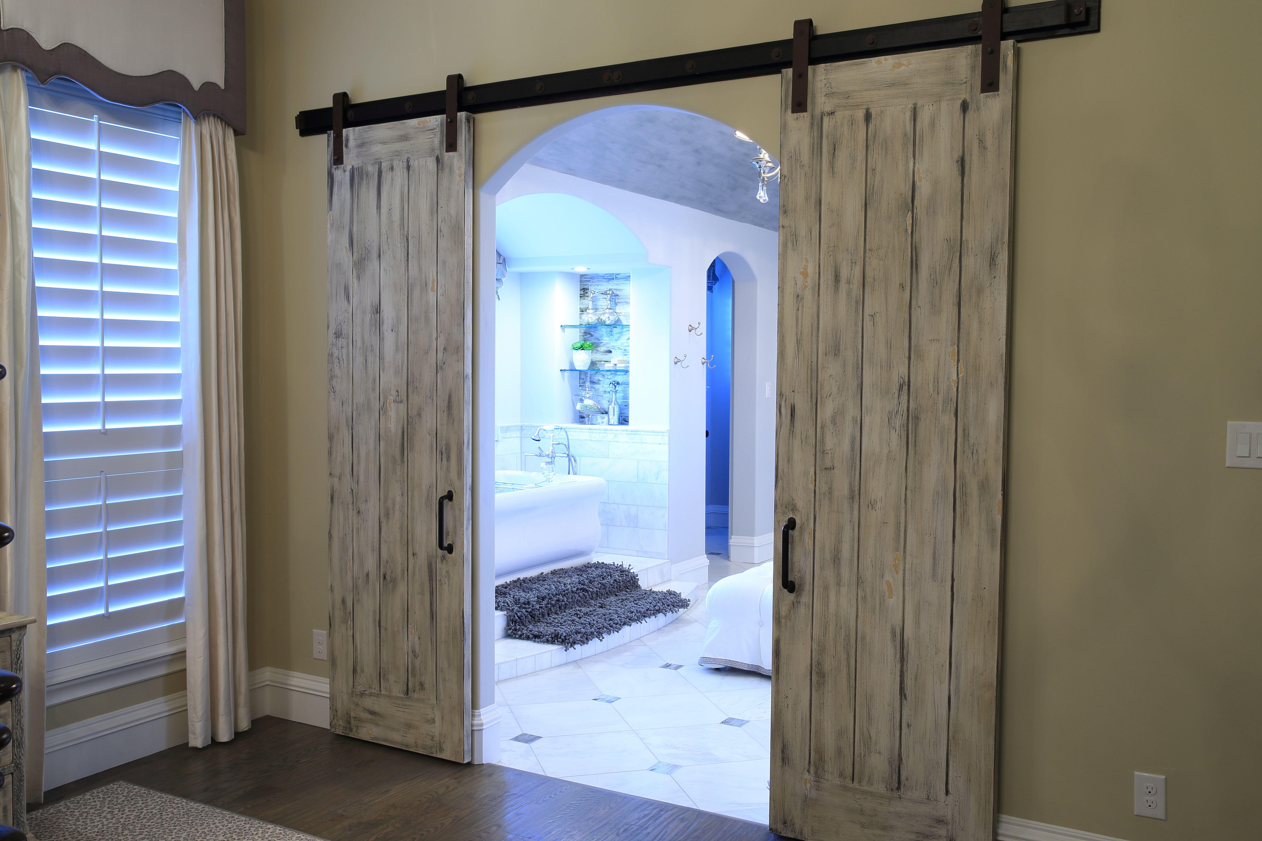 A John Askew Home. Beautiful Barn Doors opening onto the master ...