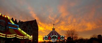 Sunset Over the Fair Amusement Park City Life Cloud - Sky Dramatic Sky Dusk Elbląg, Fair, Famous Place Illuminated Orange Color Poland Sky Sunset Sunsets Tourism Travel Destinations