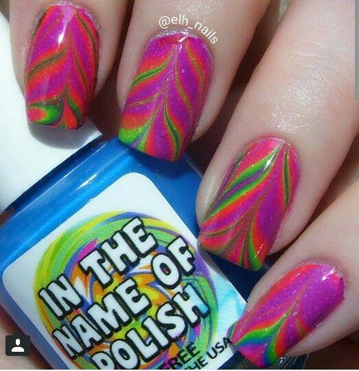 IG: @elh_nails Polishes used #inthenameofpolish Hard Knock Life collection #watermarble #mani #manicure #glitter #sparkles #nailart #nails #polish #nailpolish