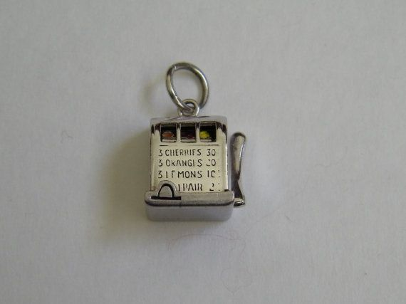 * ♥`•.¸¸.•´´•:*´¨`*:•.••.¸¸. ´´¯`•♥ *    This is an awesome sterling silver slot machine charm that is spin able by pulling the lever. Great