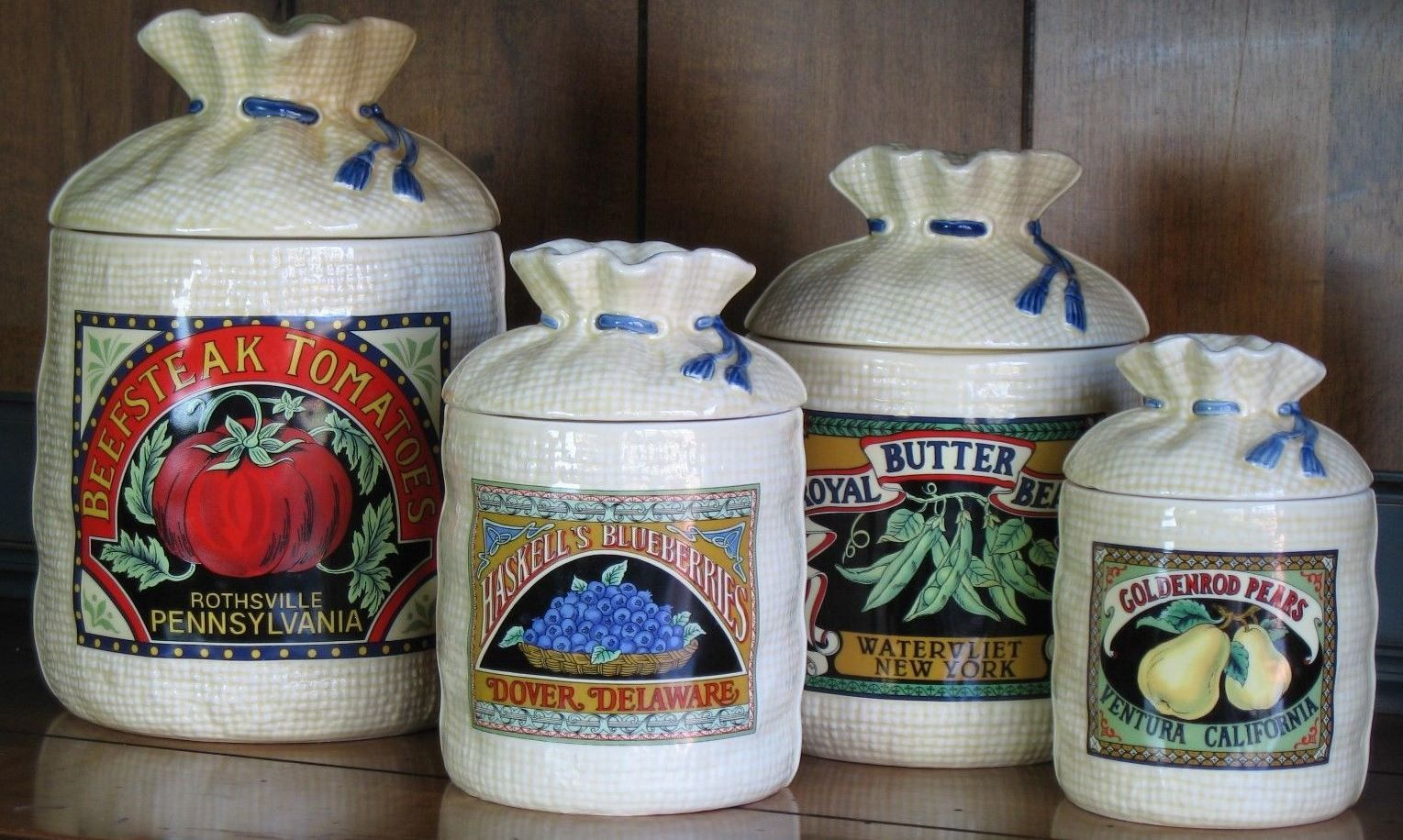 The four primary canisters flour sugar coffee and tea for Hearth and home designs canister set