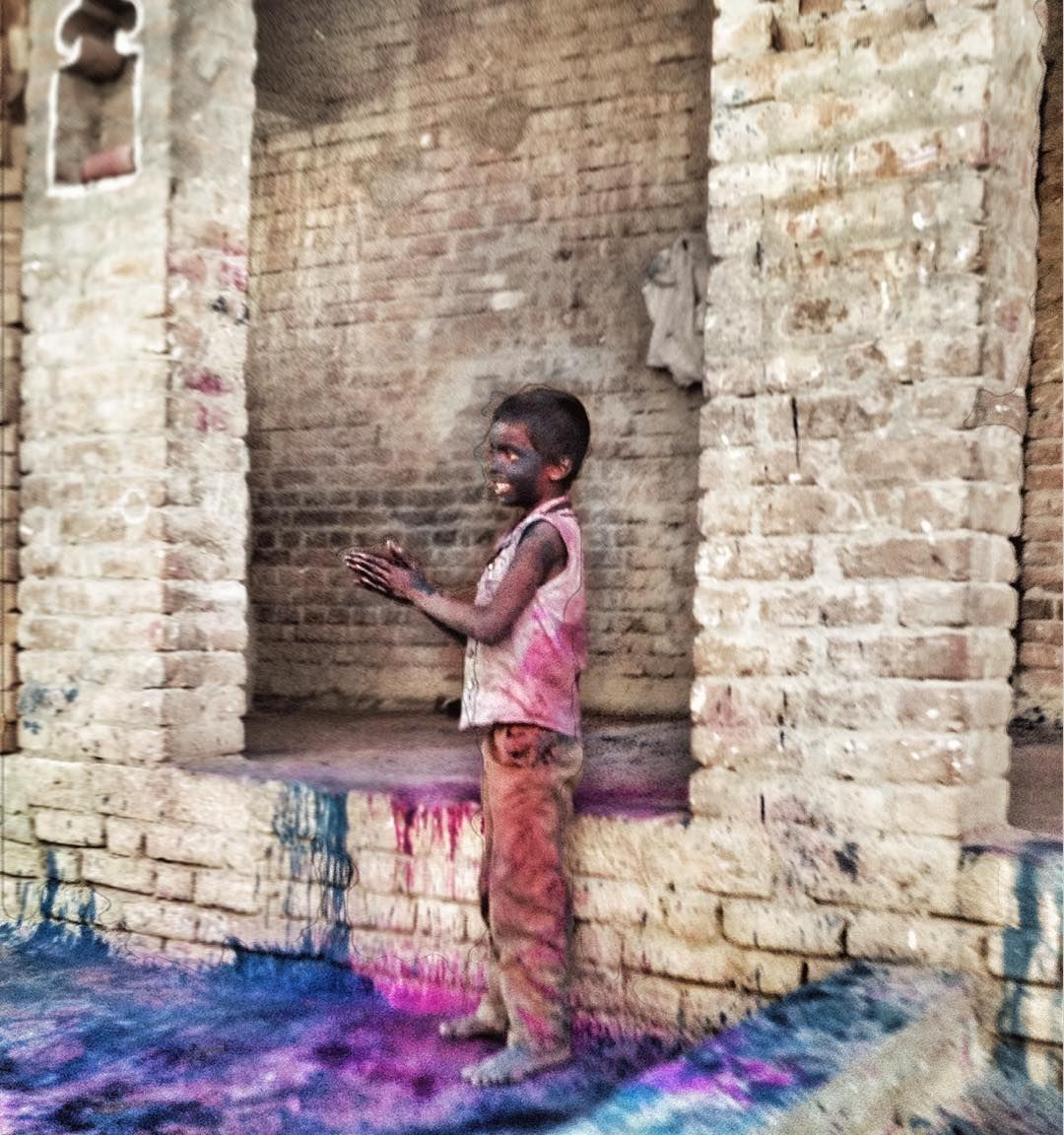 A young boy playing Holi<3 #uttarpradesh #village #holi #festival #india #colours #vibrant #love #fun #happy #boy #smiling #iphonography by itisha_singh