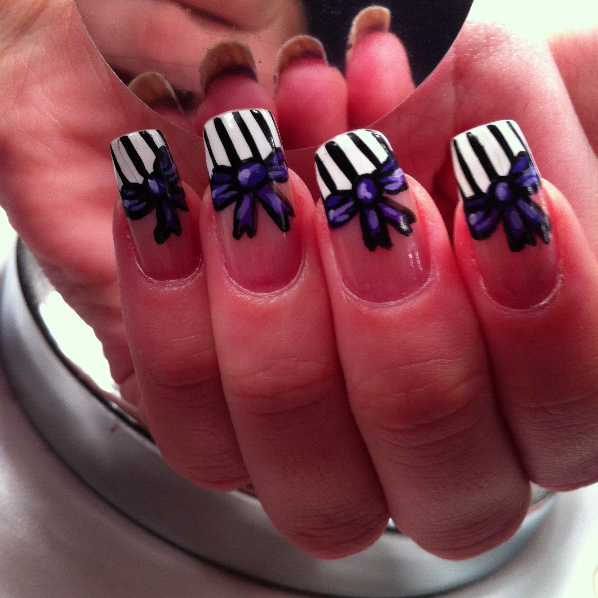 My purple bow nails