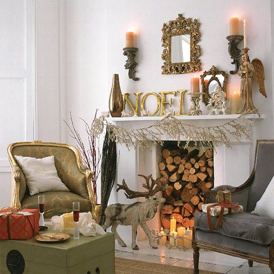 Fireplace with chairs and Christmas decorations Pinterest