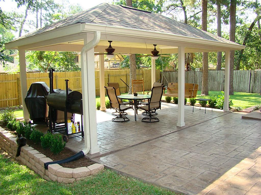 A stamped and stained concrete extension leads you from for Porch and patio designs