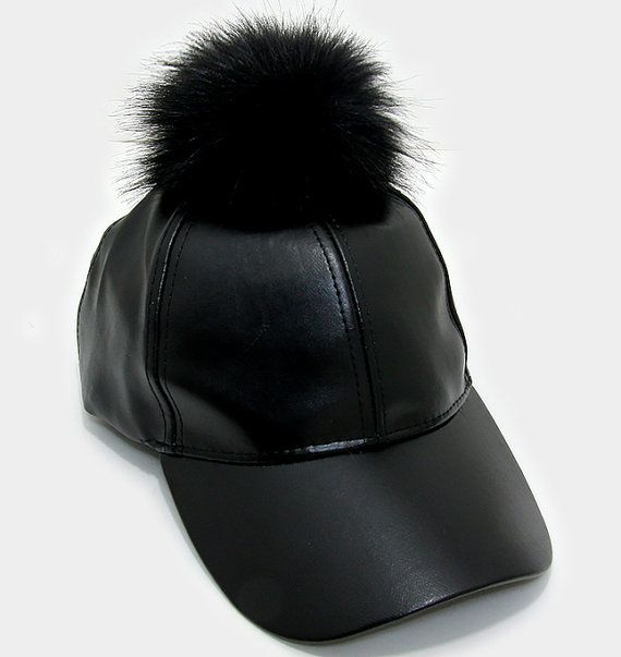 f5b8cad946c Turn heads with this trendy baseball cap with a fur pom pom. Size  11 Rim    7 Inner Diameter - Adjustable   7.5 Height