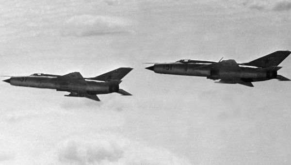 """Captured/defected Mikoyan Mig-21 """"Fishbeds"""" being tested  over the notorious """"Area 51""""."""