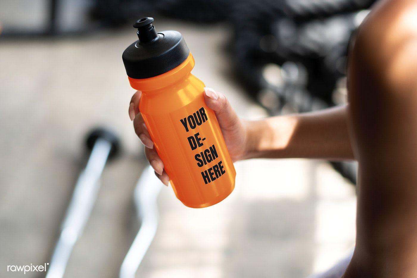 Download Download Premium Psd Of Muscular Man Holding An Orange Water Bottle Mockup In 2020 Bottle Mockup Bottle Orange Water