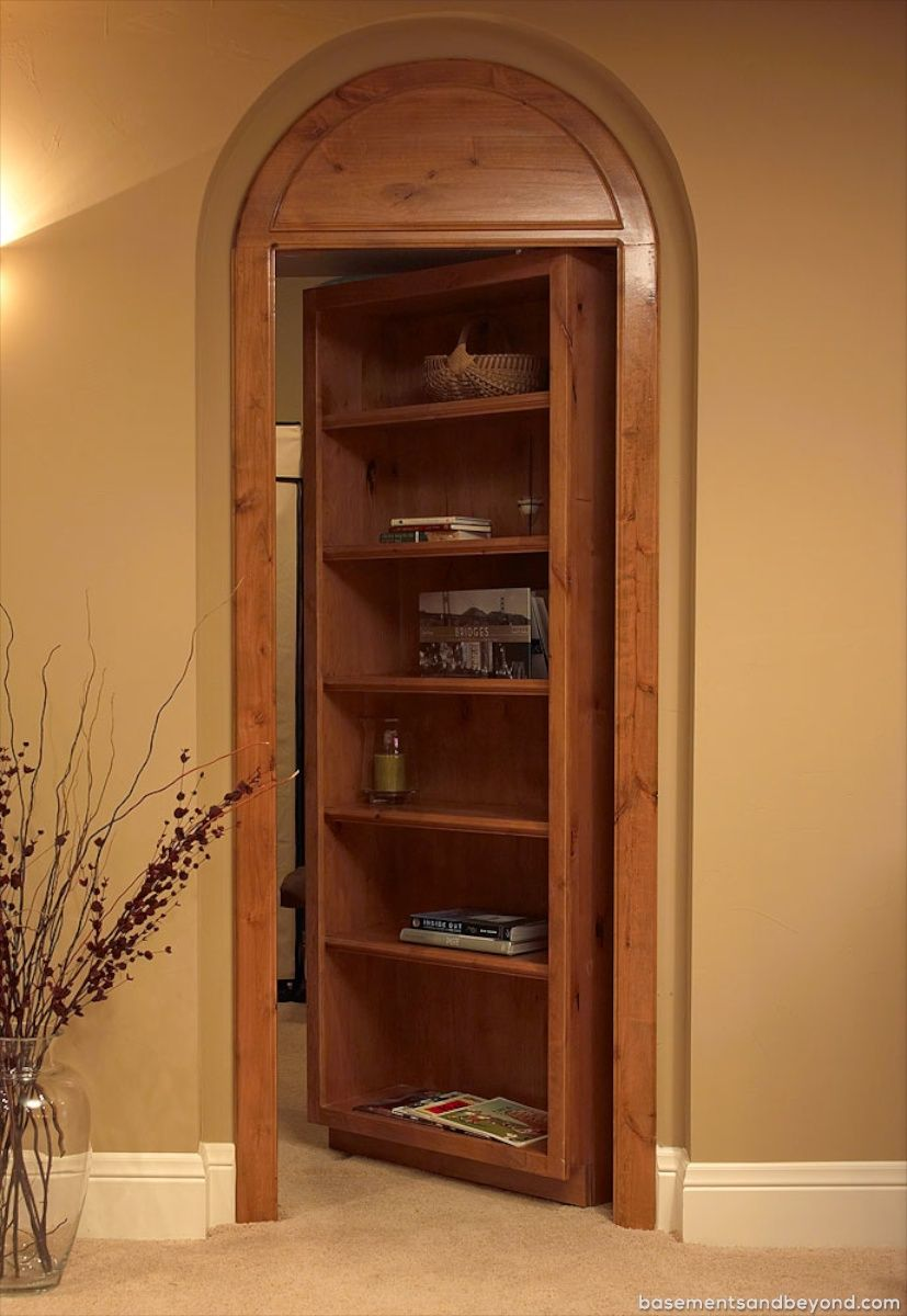 Basement Rich In Architectural Details Remodeling By Basements Beyond This Elaborate Space Features Custo Bookcase Door Bookshelves Built In Hidden Rooms