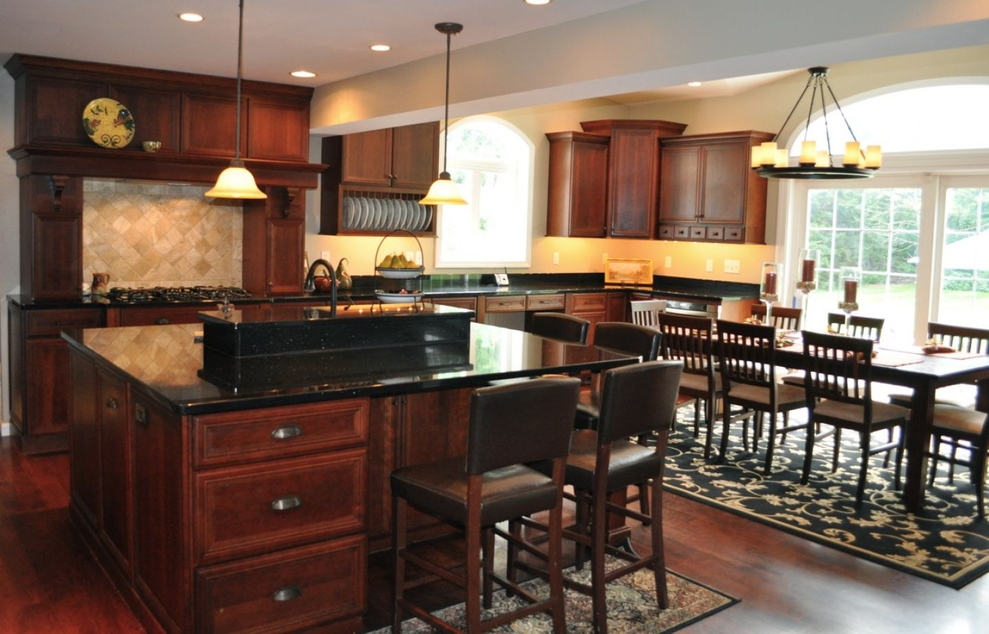 Kitchen cabinets with black granite countertop cherry for Black kitchen design