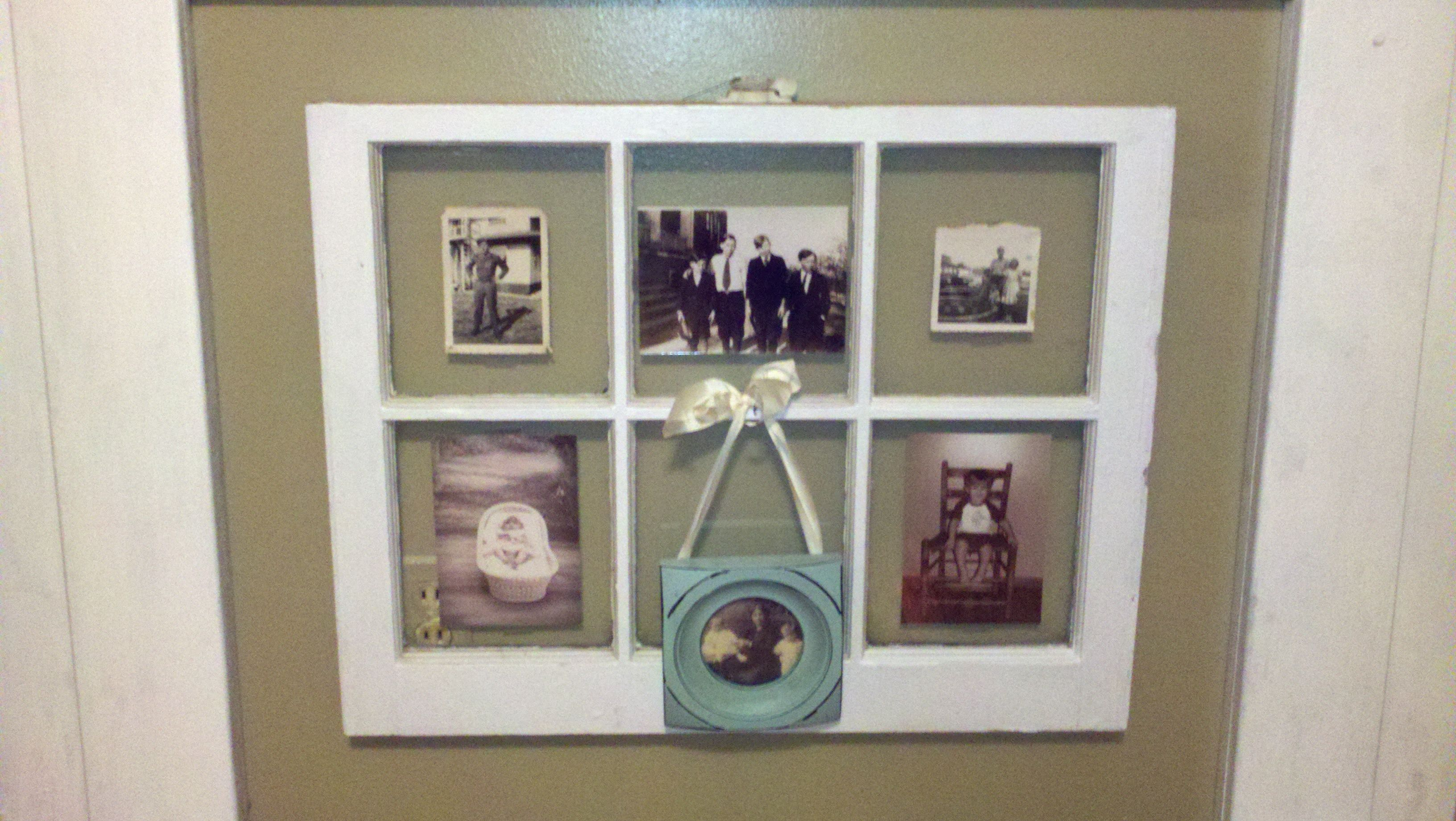Black & White Family Pics In An Old Wooden Window