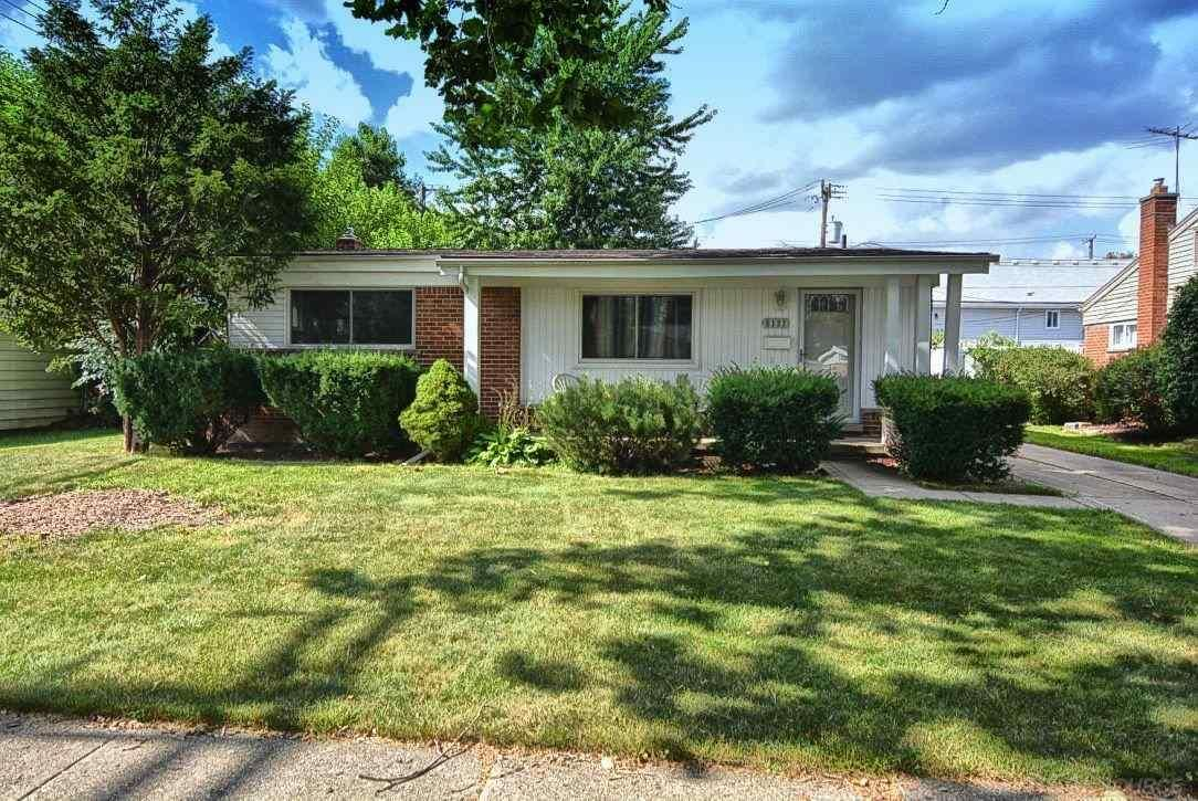 Cute and completely updated ranch situated on tree lined ...