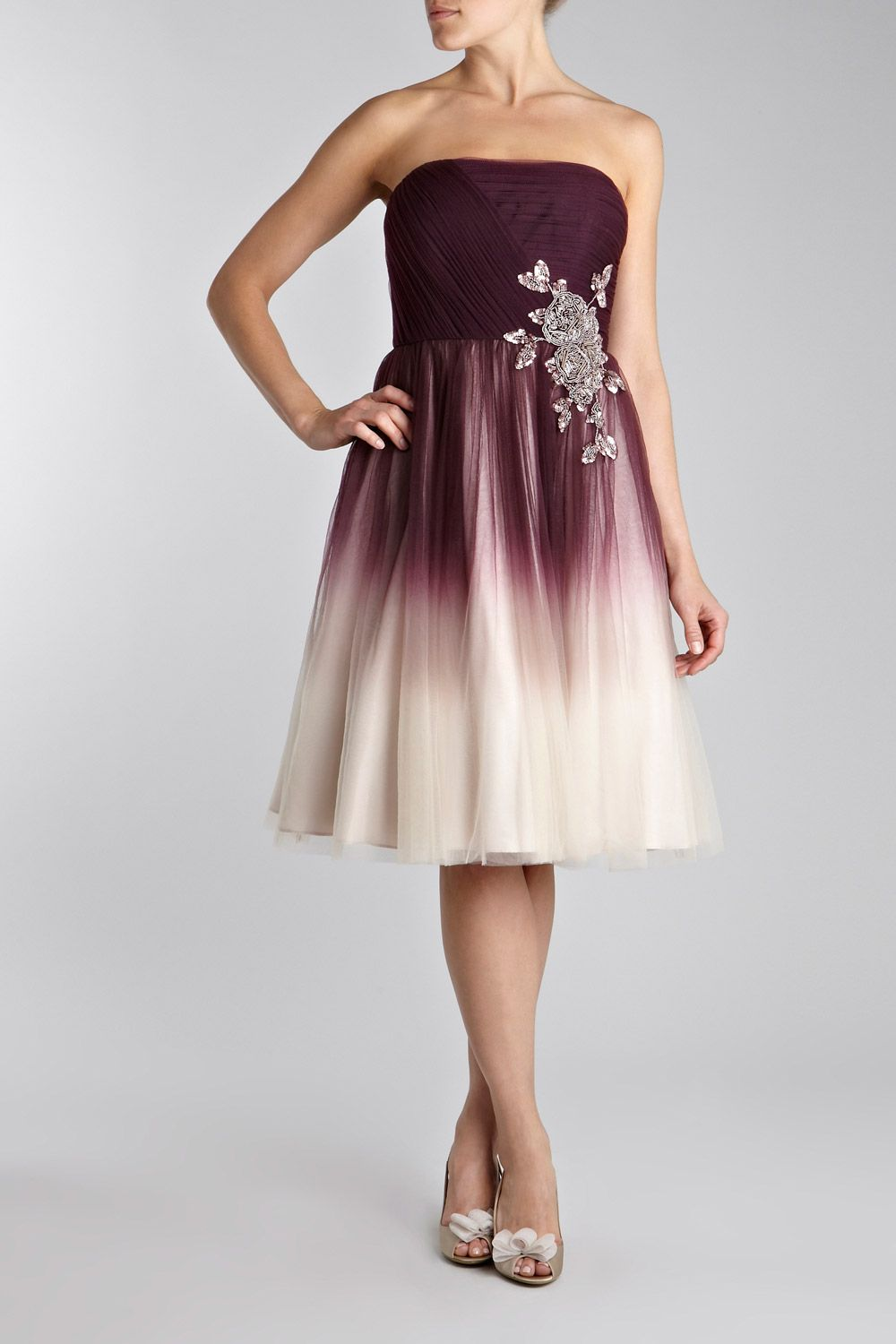 Love this dress even better without the motif thing on the left but
