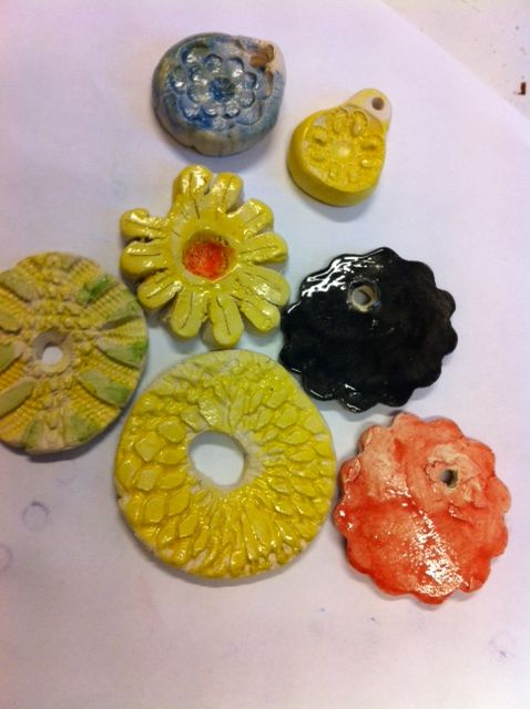 Ceramic with children, we use lace for the patterns....