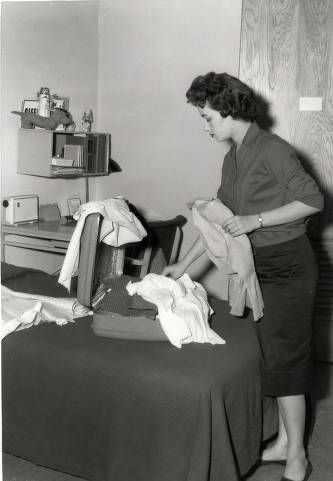 McNeese student moves into a dorm room. 1950.  Historic Photographs of Southwest Louisiana