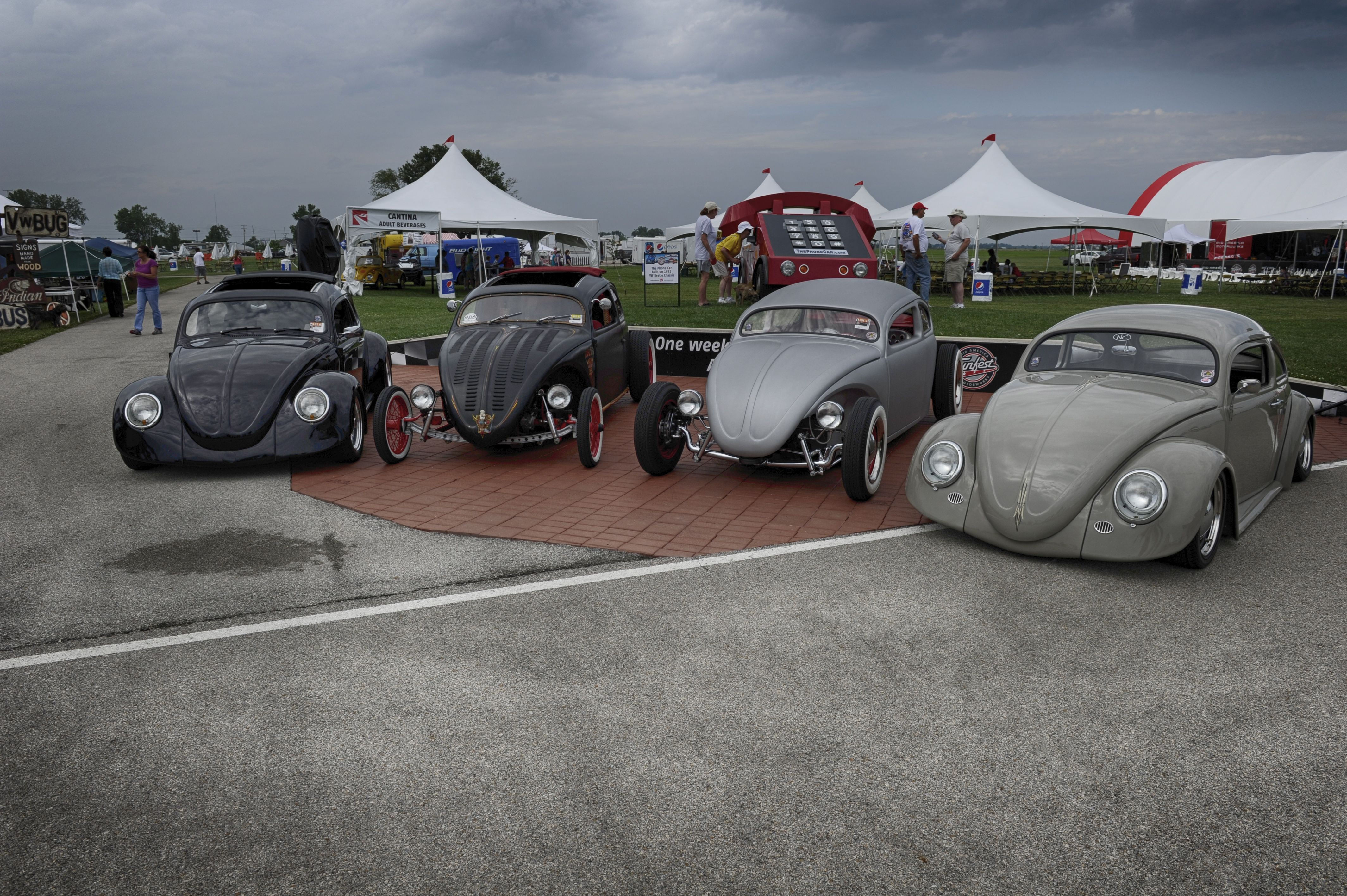 4 Hot Rods at the Funfest Pit Wall during Funfest for Air Cooled VW
