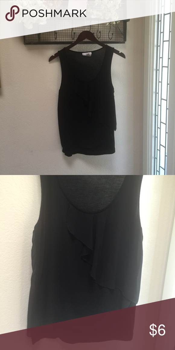 Black layered tank top Super soft back lining. Ruffles layered look in front. Goes with everything. 25 in. from shoulder to bottom hem Kenar Tops Tank Tops